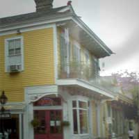 Quarter Scene Restaurant Ghost on the Balcony and neighboring roof, ghpst photo by Frank Paglesi.