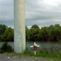 A ghostly face on the colomn on a road marker in New Orleans east, Photo sent to us by Sheile Hebert.